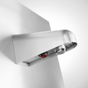 Faucet with integrated touch-free sensor